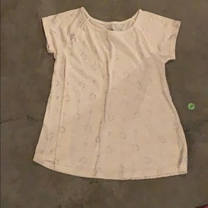 White top size 10 with silver design